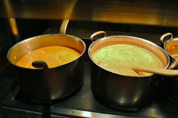 2 pots of soup on a buffet