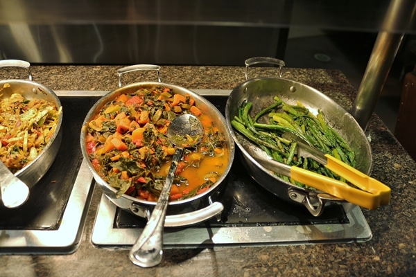 pans of vegetables on a buffet line
