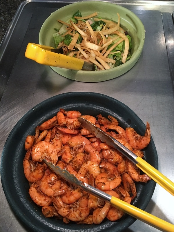 shrimp and salad in a buffet