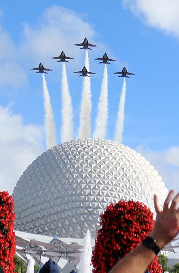 the Blue Angels airplanes flying over Spaceship Earth in Epcot