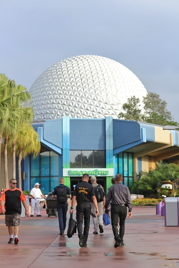 A group of people walking toward Spaceship Earth in Epcot