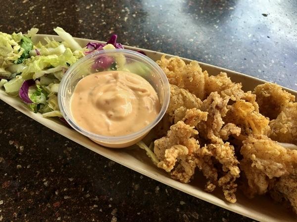 fried calamari with sauce on a long platter