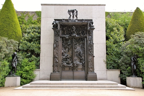 Rodin\'s famous Gates of Hell sculpture in a garden