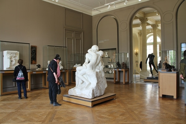 a room full of sculptures in a museum