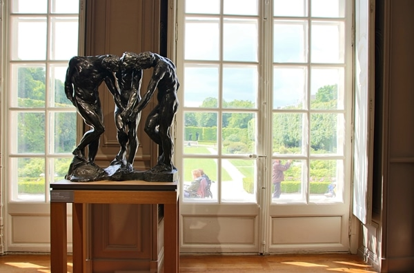 sculptures next to a large window overlooking a garden