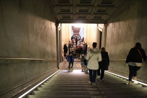 people walking down a staircase