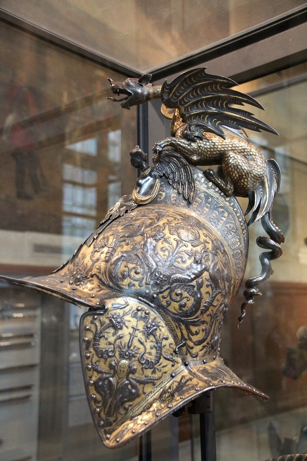 a metal helmet with a dragon on top