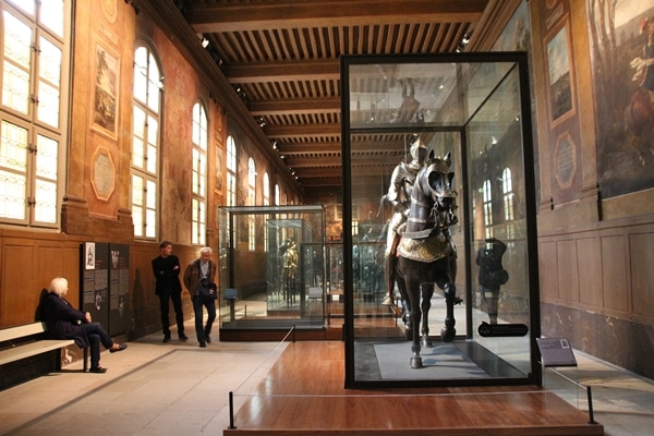 a museum display of suits of armor on horses