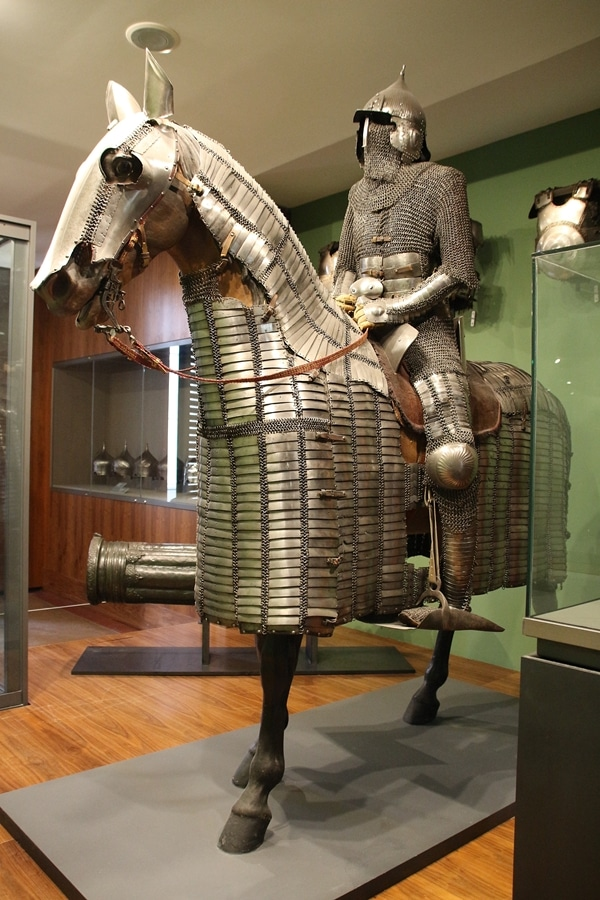 a suit of armor on top of an armored horse