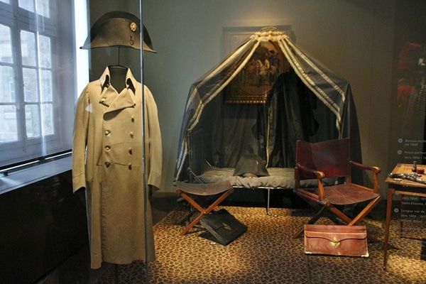 a museum display of Napoleon\'s clothing and camp setup