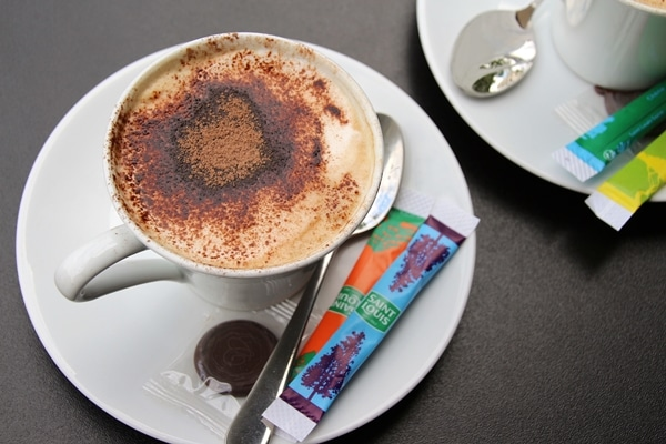 overhead view of a cappuccino topped with cocoa powder