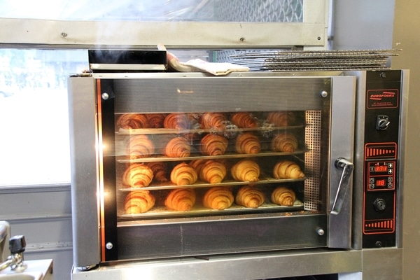 croissants baking in an oven