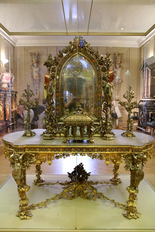 An intricately designed vanity table and mirror in a museum