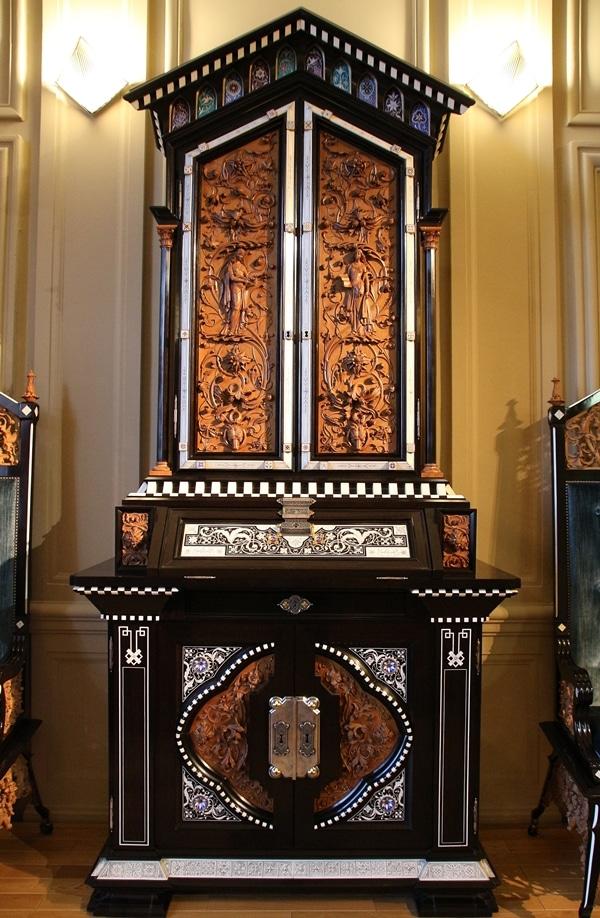 an ornately carved wooden dresser