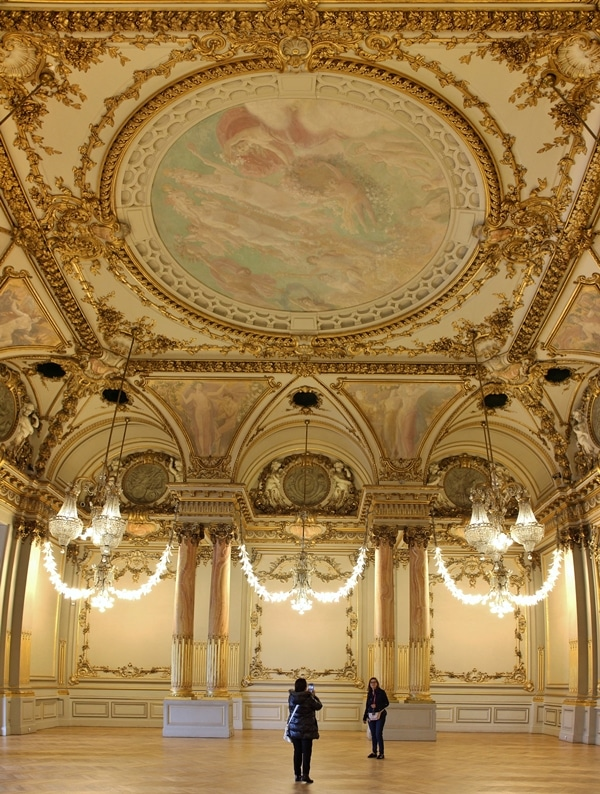 A large room with tall painted ceilings