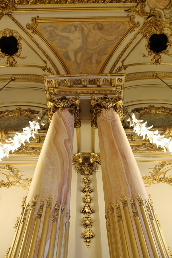 A close up of marble columns in a fancy room
