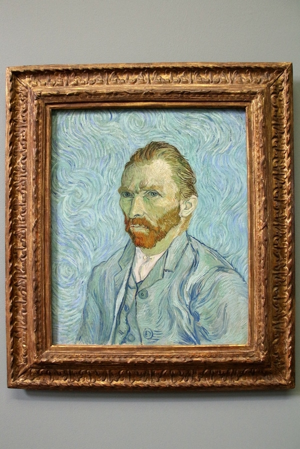 A painted portrait of a man with a blue background
