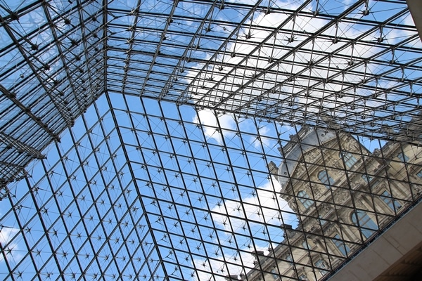 view from beneath the glass pyramid of the Louvre