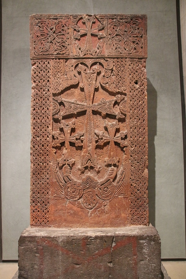 a cross carved in stone