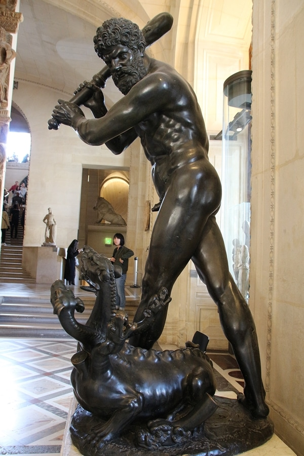 A statue of a man fighting a beast