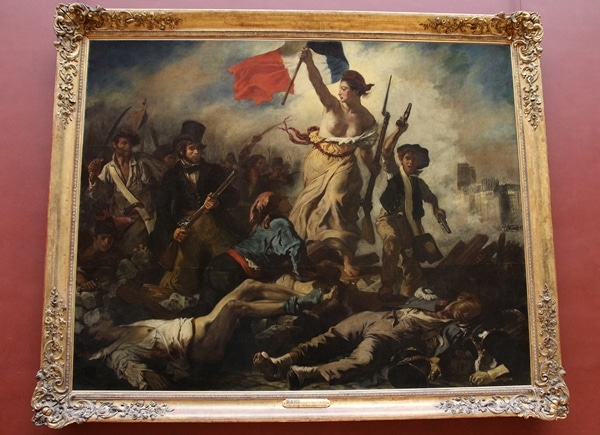 A painting of a woman with a French flag over a group of fallen people