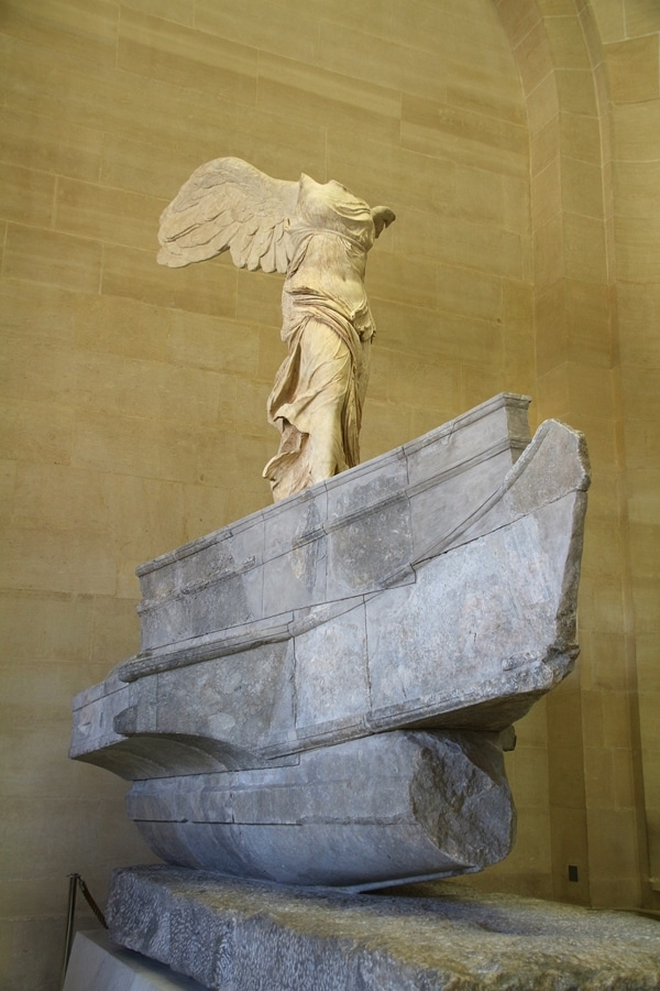 A statue of a headless woman with wings