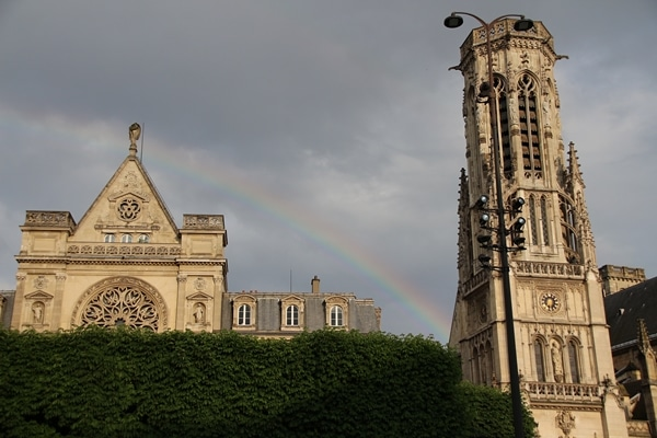a rainbow over a church