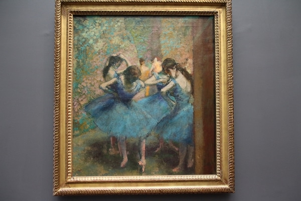 A painting of a group of ballet dancers wearing blue