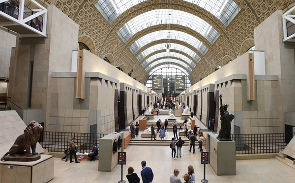 the vast interior of the Musée d\'Orsay filled with sculptures