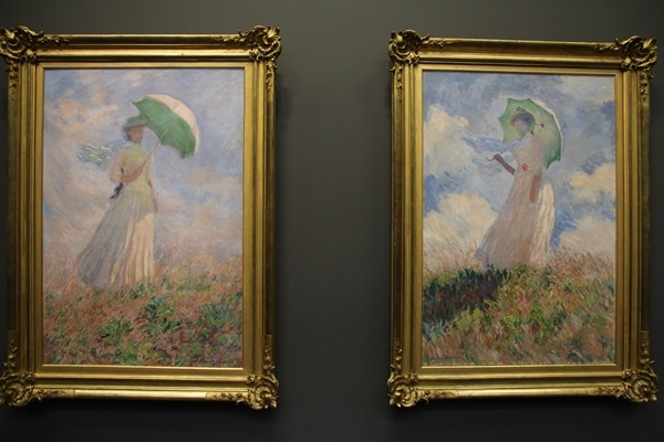 2 paintings of women holding green parasols