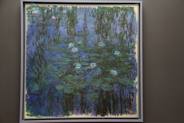 A painting of lilies in a pond