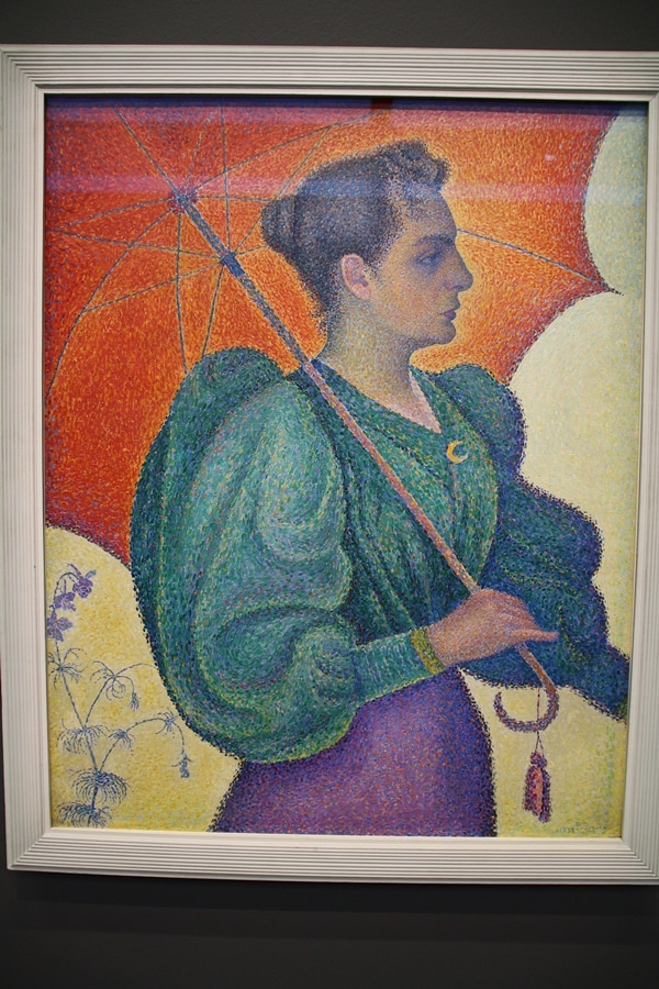a painting of a woman with an umbrella