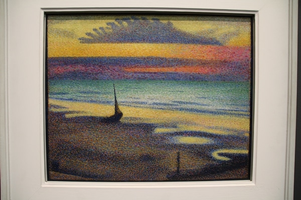 A painting of a shore at sunset