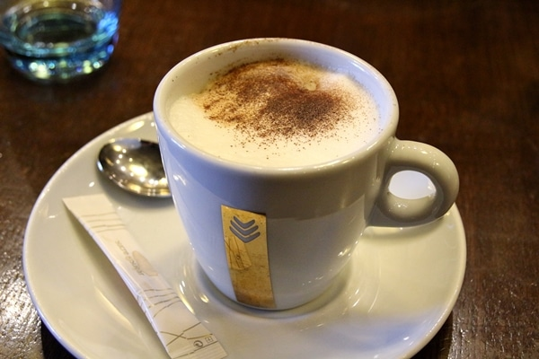 A cup of Cappuccino topped with cocoa powder