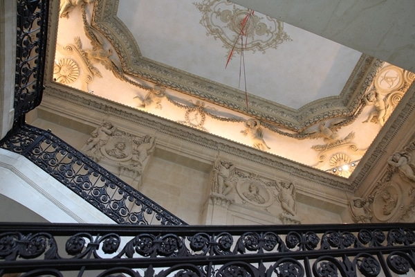 an ornate staircase in a historic building