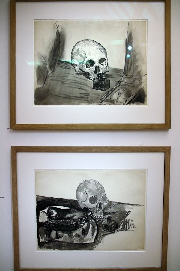 paintings of skulls in a museum