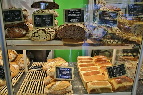 a display case of various breads