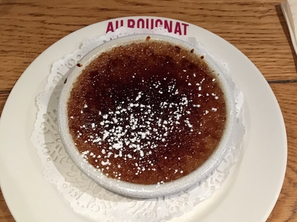 creme brulee in a white dish