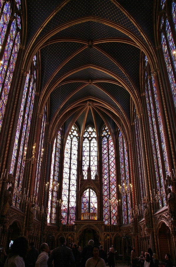 The interior of Sainte-Chapelle church with tall picture windows and vaulted ceilings