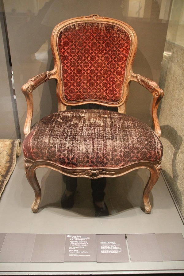 an old chair in a museum