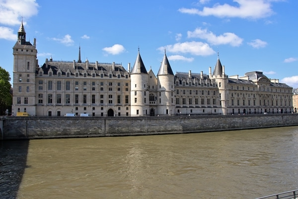 a palatial building on the shore of a river