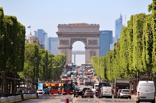 a view down the Champs-Élysées of the Arc de Triomphe in the distance