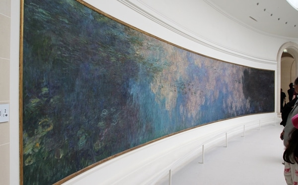 a large painting stretching across a curved wall