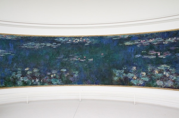 a very large rectangular painting of waterlilies