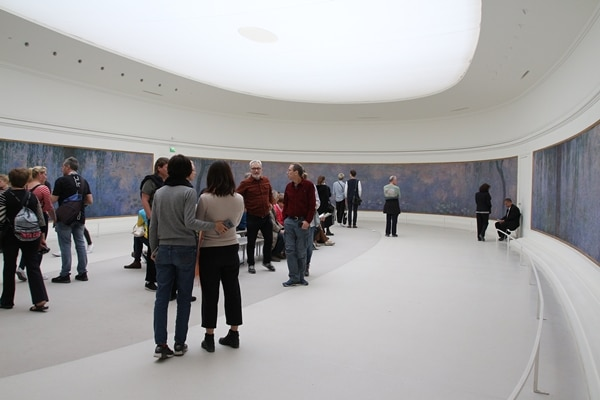 A group of people standing in a room in a museum
