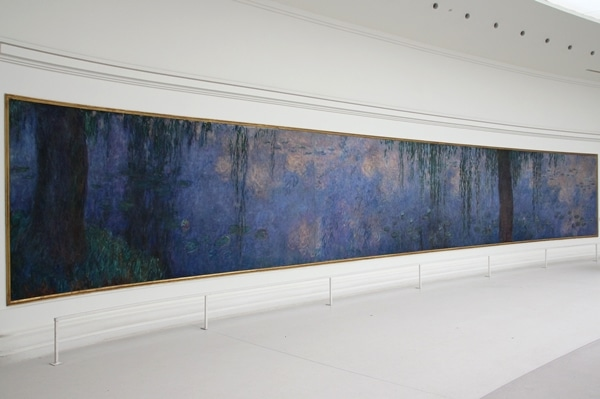 a very large rectangular painting on a white wall