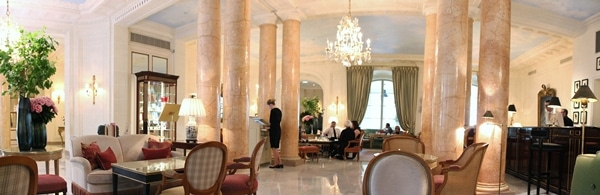 interior of a fancy hotel lounge with crystal chandeliers