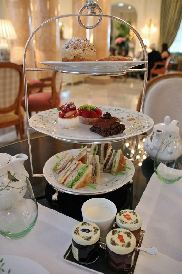 a 3-tiered presentation of Afternoon Tea with different foods on each level