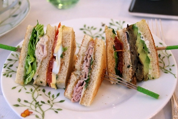 a variety of elegant tea sandwiches on a plate