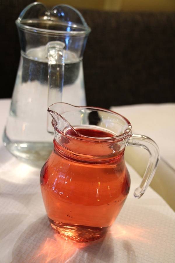 a small glass carafe of rose wine